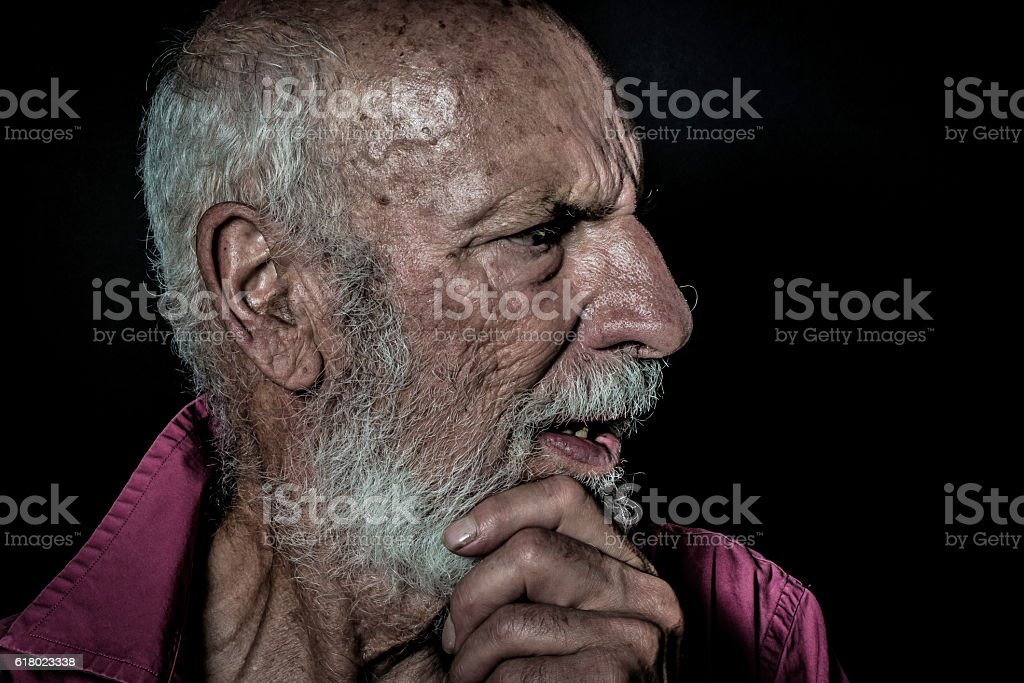 Senior man with beard with lonely and sad expression stock photo