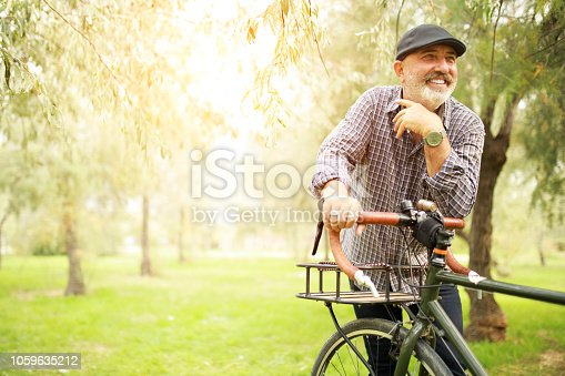 istock Senior Man With Bicycle 1059635212