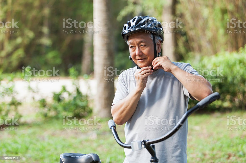 Senior man with bicycle stock photo