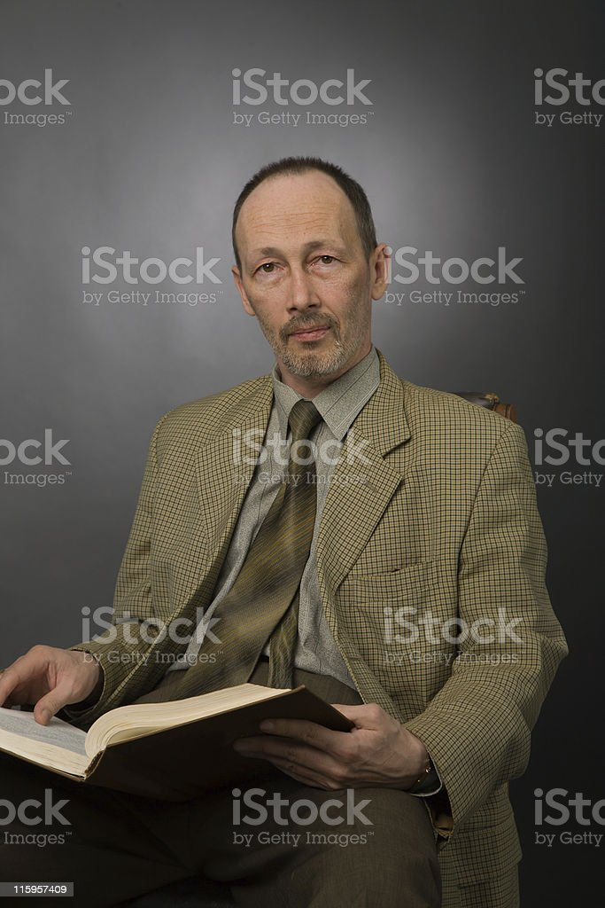senior man with book royalty-free stock photo