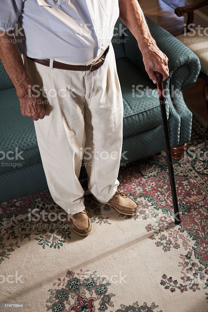 Senior man with cane stock photo