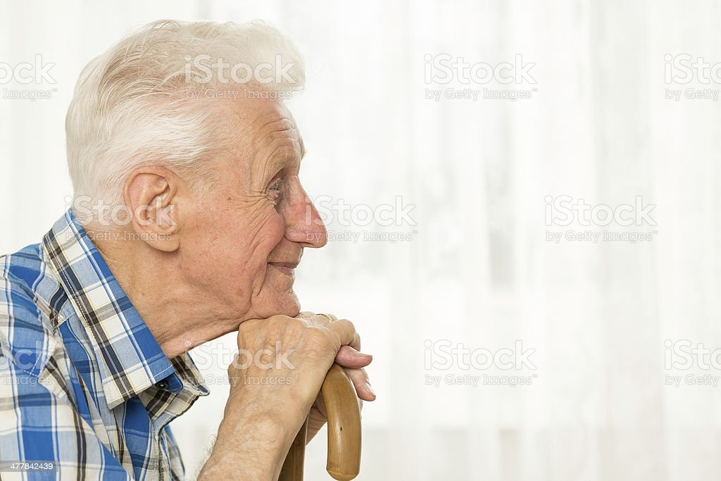 Senior man with cane royalty-free stock photo