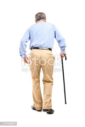istock Senior man with cane walking 147446047
