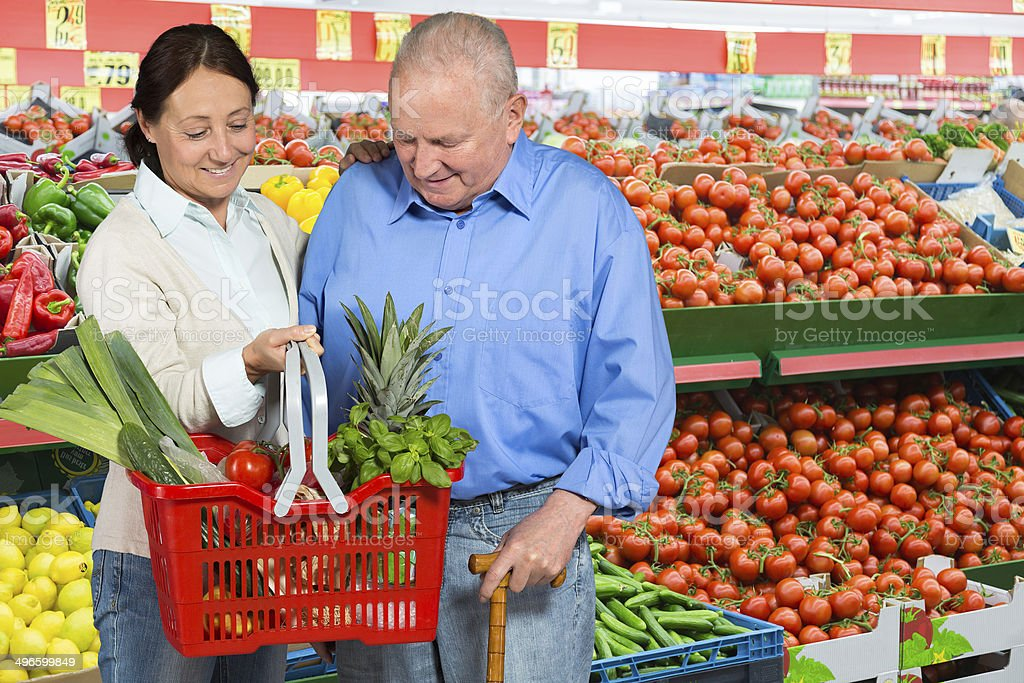 Senior man with caregiver shopping stock photo