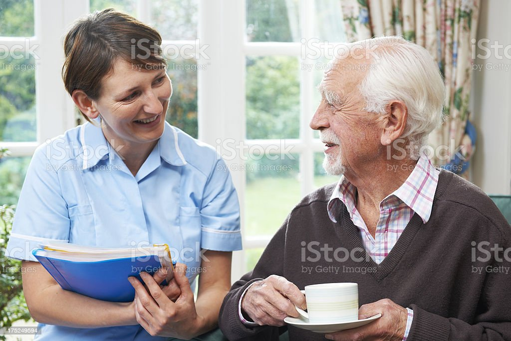 Senior man With Carer At Home royalty-free stock photo