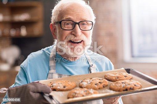 istock Senior man with cookies 683966456