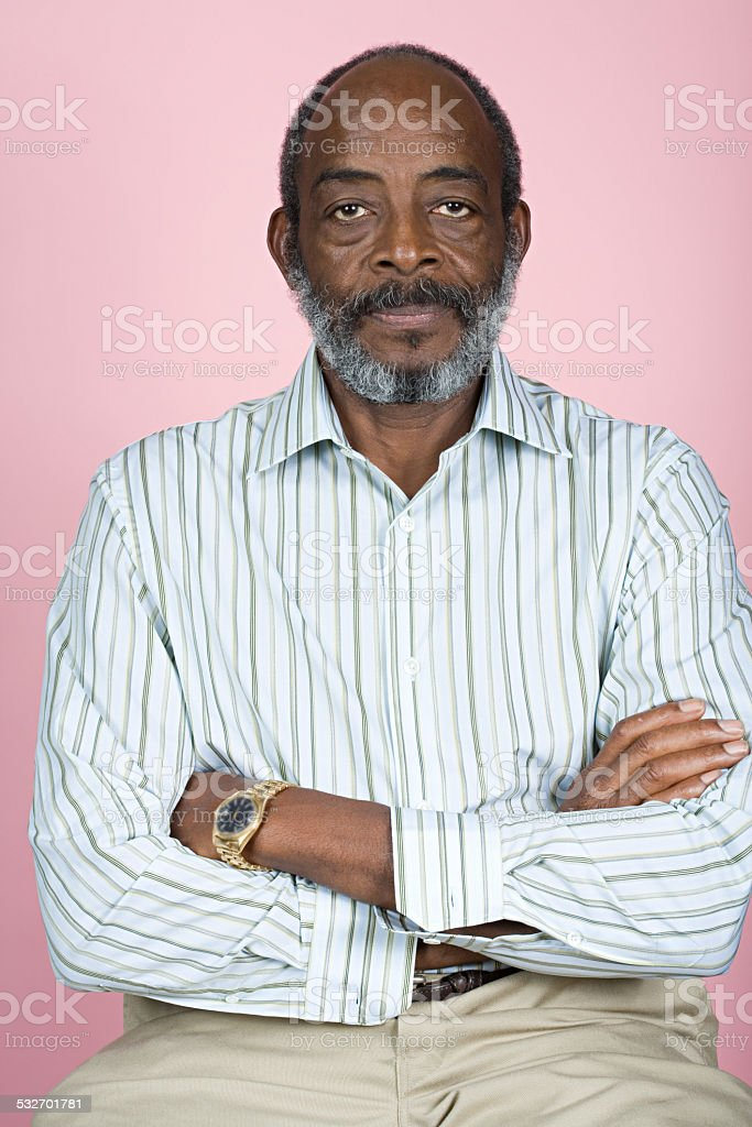 Senior man with crossed arms stock photo