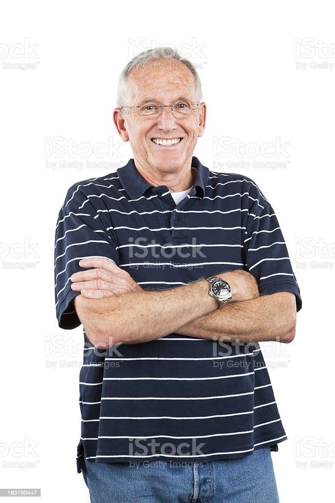 senior man with crossed arms smiles royalty-free stock photo