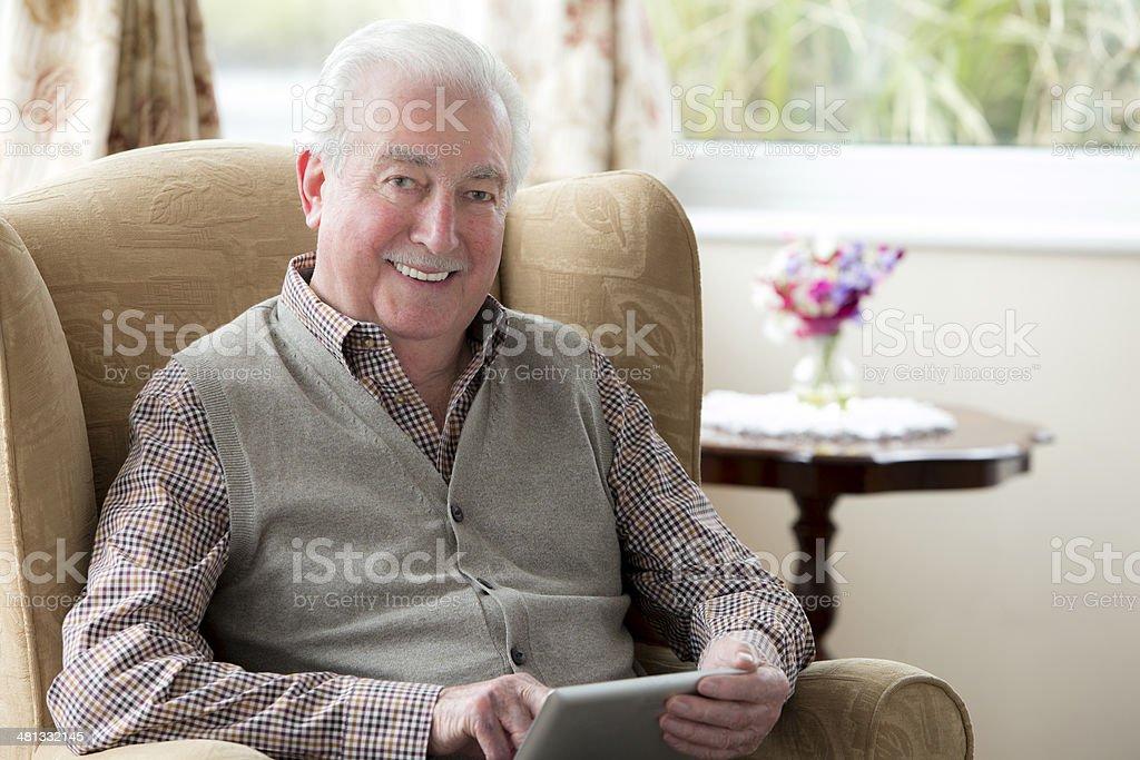 Senior Man With Digital Tablet stock photo