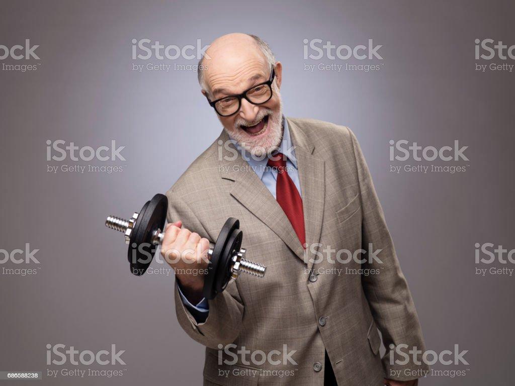 Senior man with dumbbell royalty-free stock photo