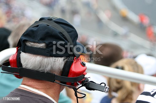 173015172 istock photo Senior Man With Earmuffs at Racing Event 173026596
