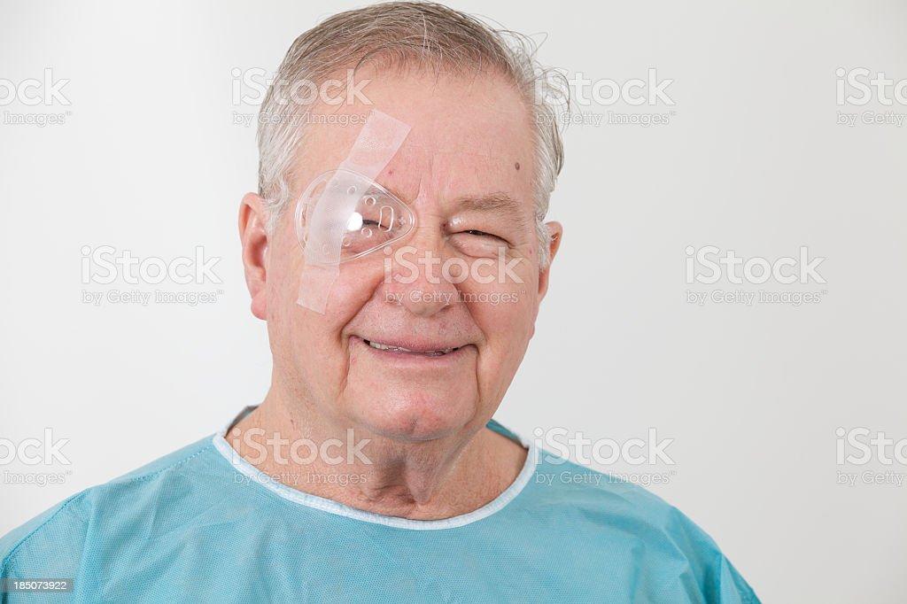 Senior man with eye surgery stock photo