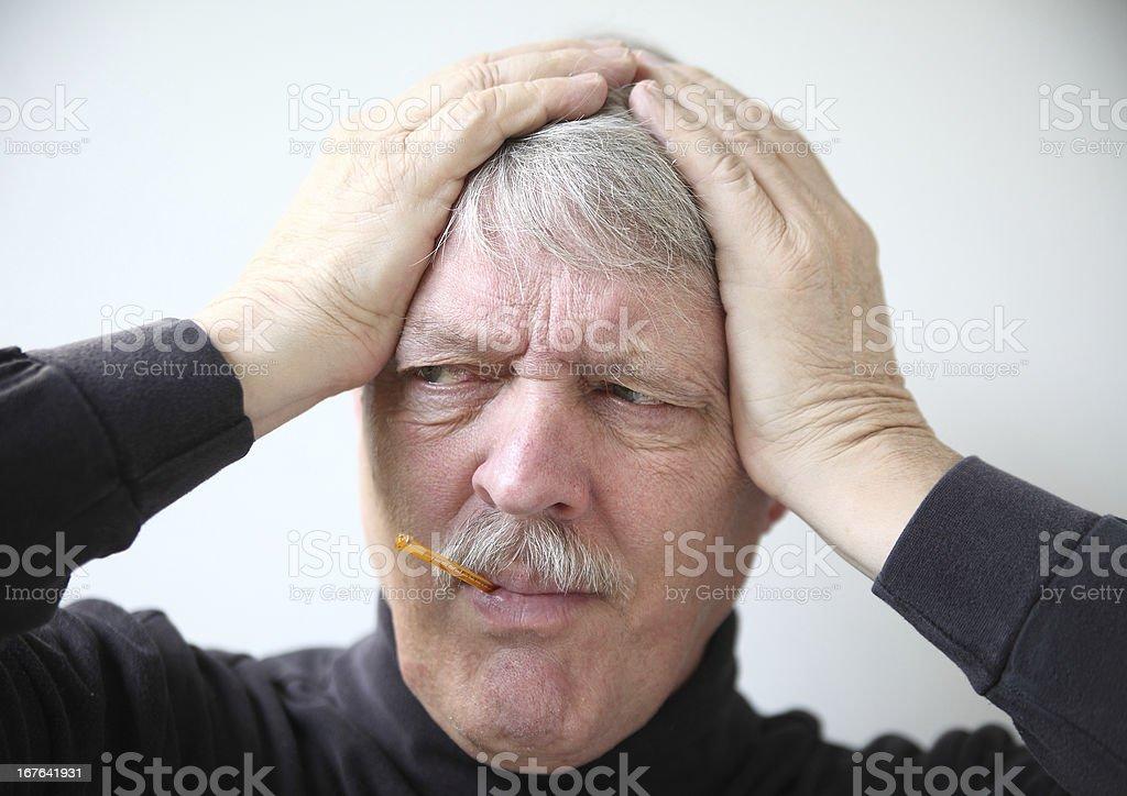 senior man with flu symptoms royalty-free stock photo