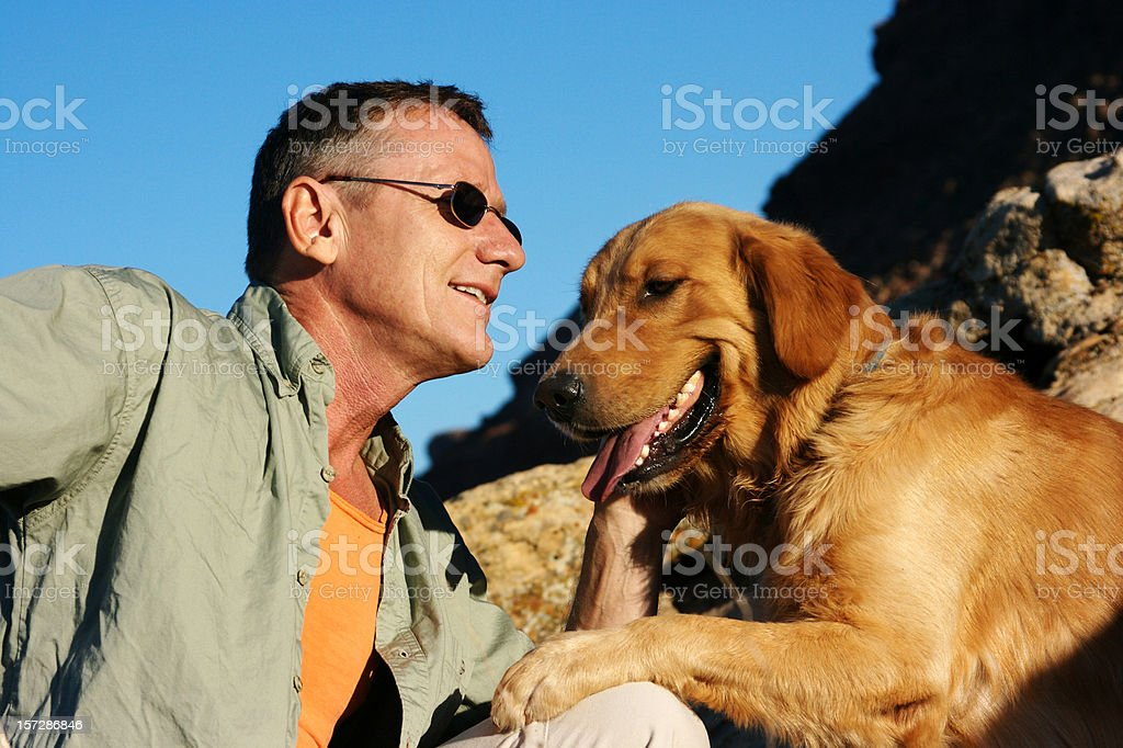 Senior Man with Golden Retriever royalty-free stock photo