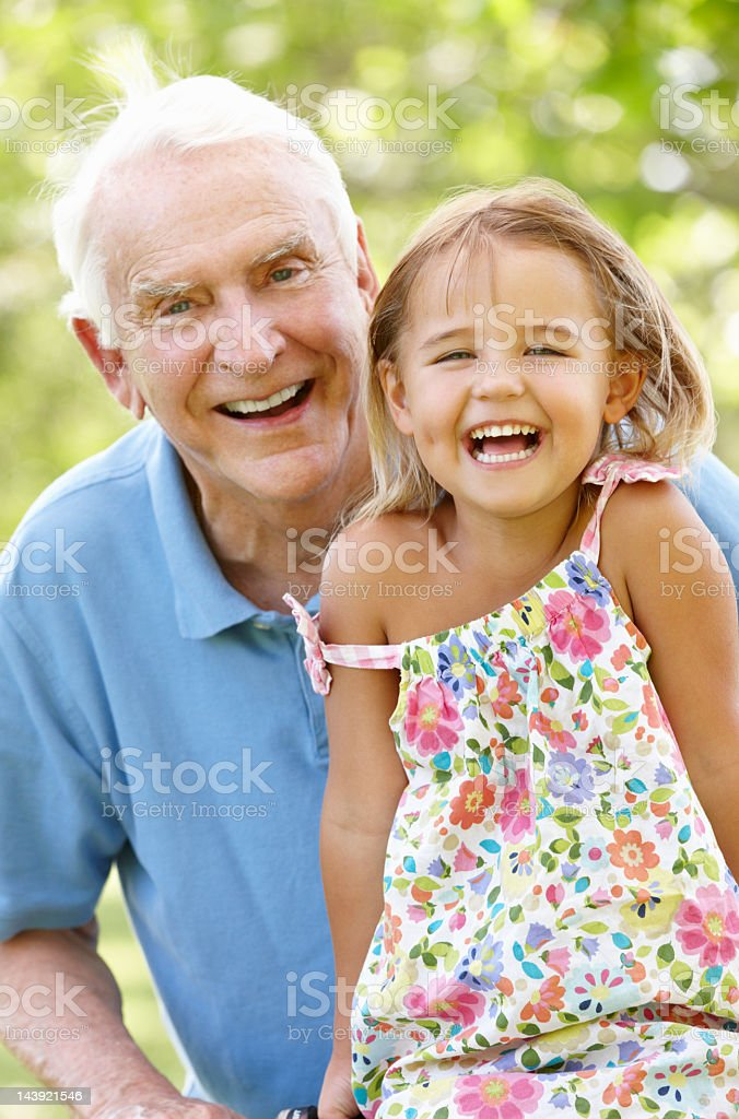 Senior man with granddaughter royalty-free stock photo