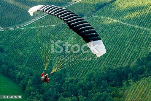 Senior man with gray long beard paragliding in Julian Alps, Primorska Region in Slovenia, Europe,Nikon D850