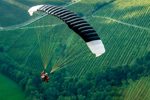 Senior man with gray long beard paragliding in Julian Alps, Primorska Region in Slovenia, Europe Senior man with gray long beard paragliding in Julian Alps, Primorska Region in Slovenia, Europe,Nikon D850 paragliding stock pictures, royalty-free photos & images