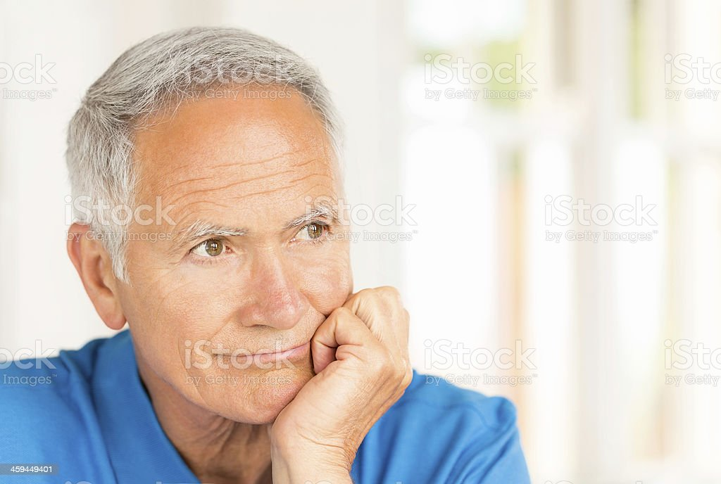 Senior Man With Hand On Chin Deep In Thought. royalty-free stock photo