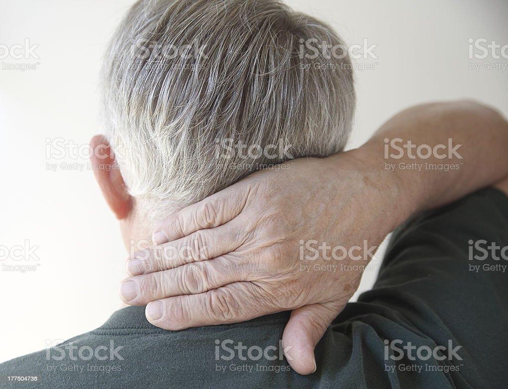 senior man with hand on neck royalty-free stock photo