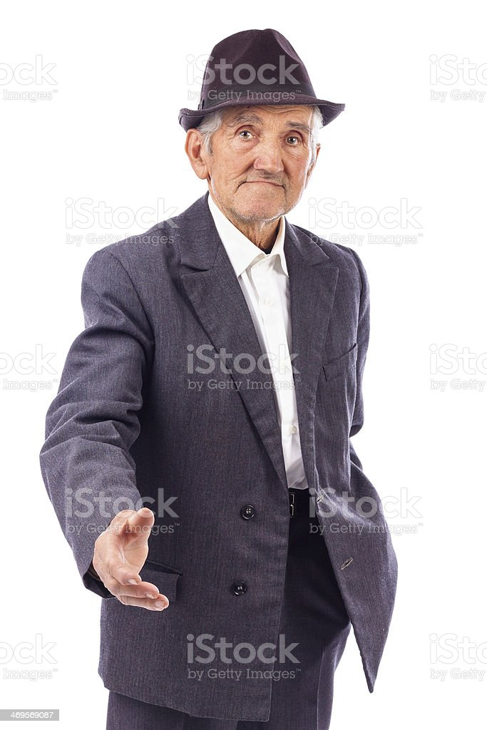 Senior man with hand outstretched  for a handshake royalty-free stock photo