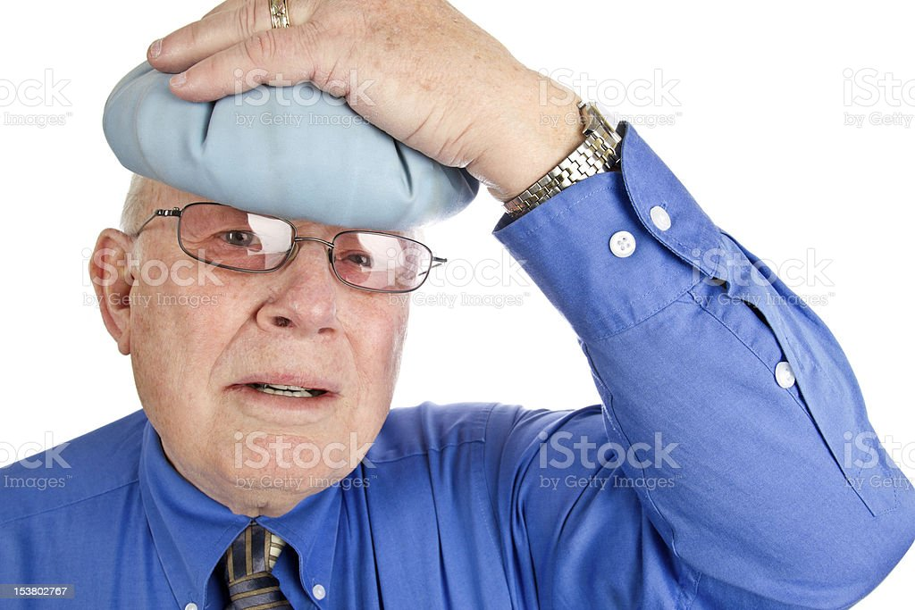 Senior Man with Headache and Ice Pack on Head royalty-free stock photo