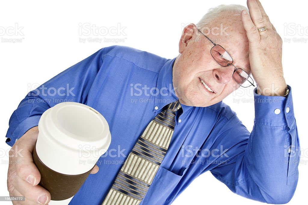 Senior Man with Headache and To Go Coffee in Hand royalty-free stock photo