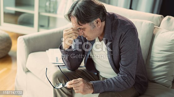 626964348istockphoto Senior man with headache 1157747722