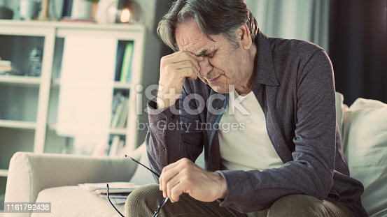 626964348istockphoto Senior man with headache 1161792438