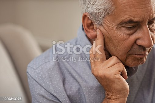 1029343276istockphoto Senior man with hearing problems 1029343276