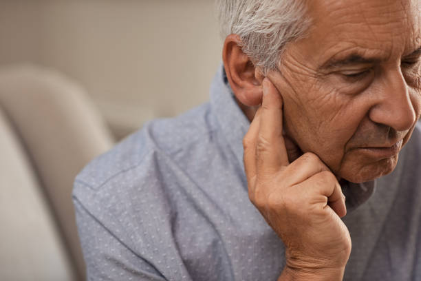 senior man with hearing problems - ear stock photos and pictures