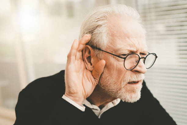 Senior man with hearing problems stock photo