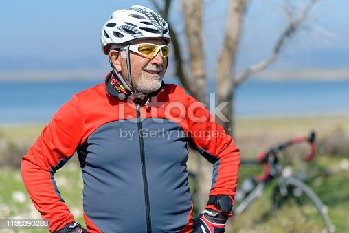 1029243348 istock photo Senior man with his bike 1135393288