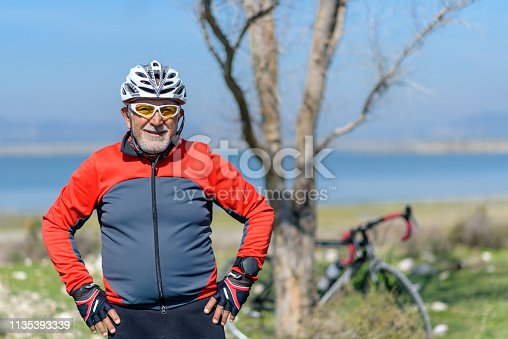 1029243348 istock photo Senior man with his bike 1135393339