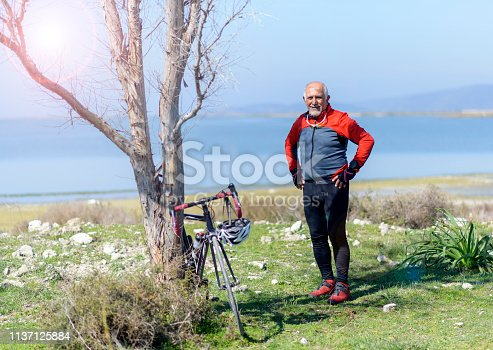 1029243348 istock photo Senior man with his bike 1137125884
