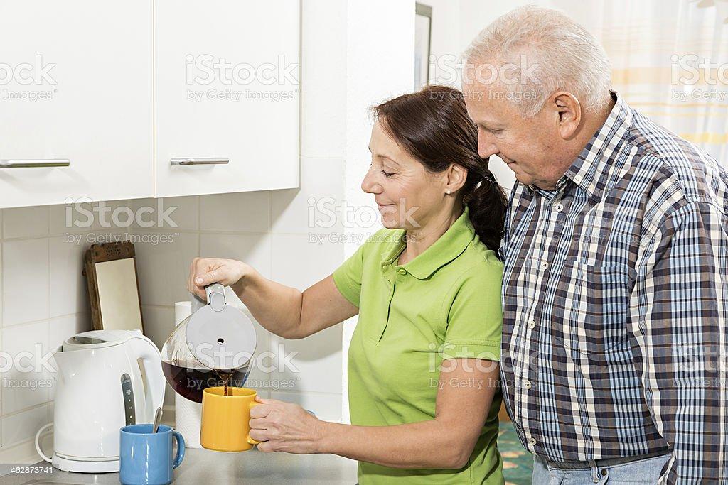 Senior man with home caregiver
