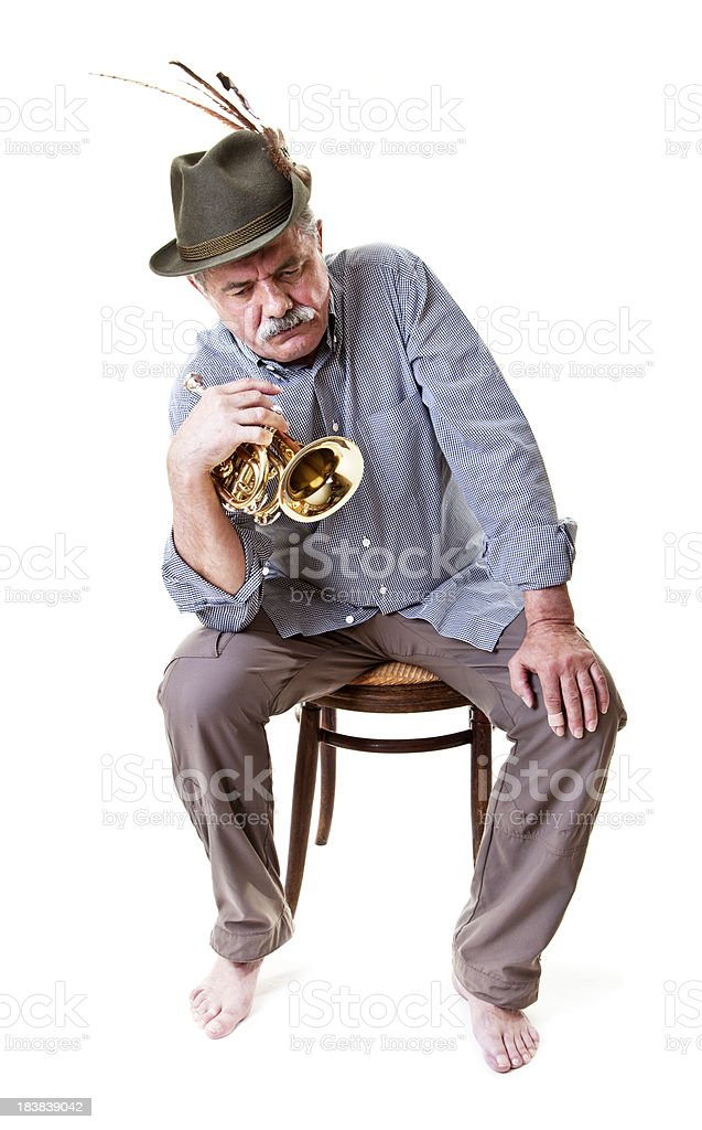 senior man with hunting hat blowing horn royalty-free stock photo