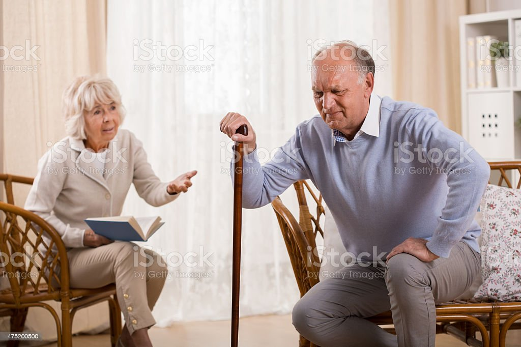 Senior man with knee arthritis stock photo