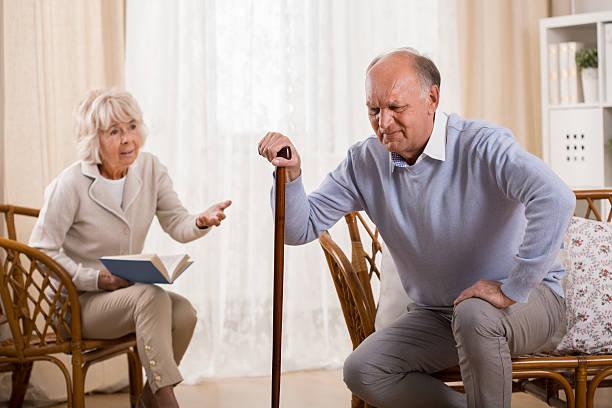 Senior man with knee arthritis stock photo