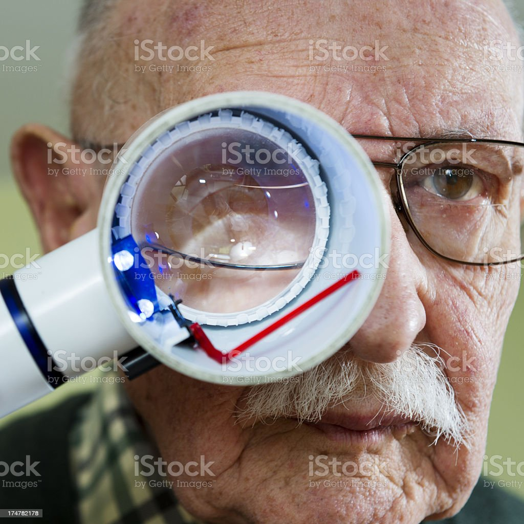 Senior Man With Macular Degeneration stock photo