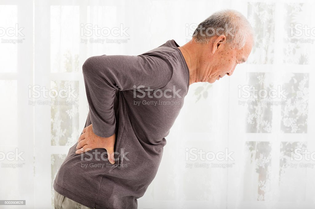 senior man with Pain in back stock photo