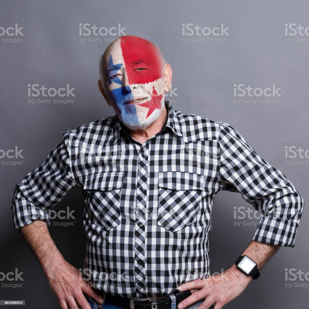 Senior man with Panama flag painted on his face - Royalty-free Adult Stock Photo