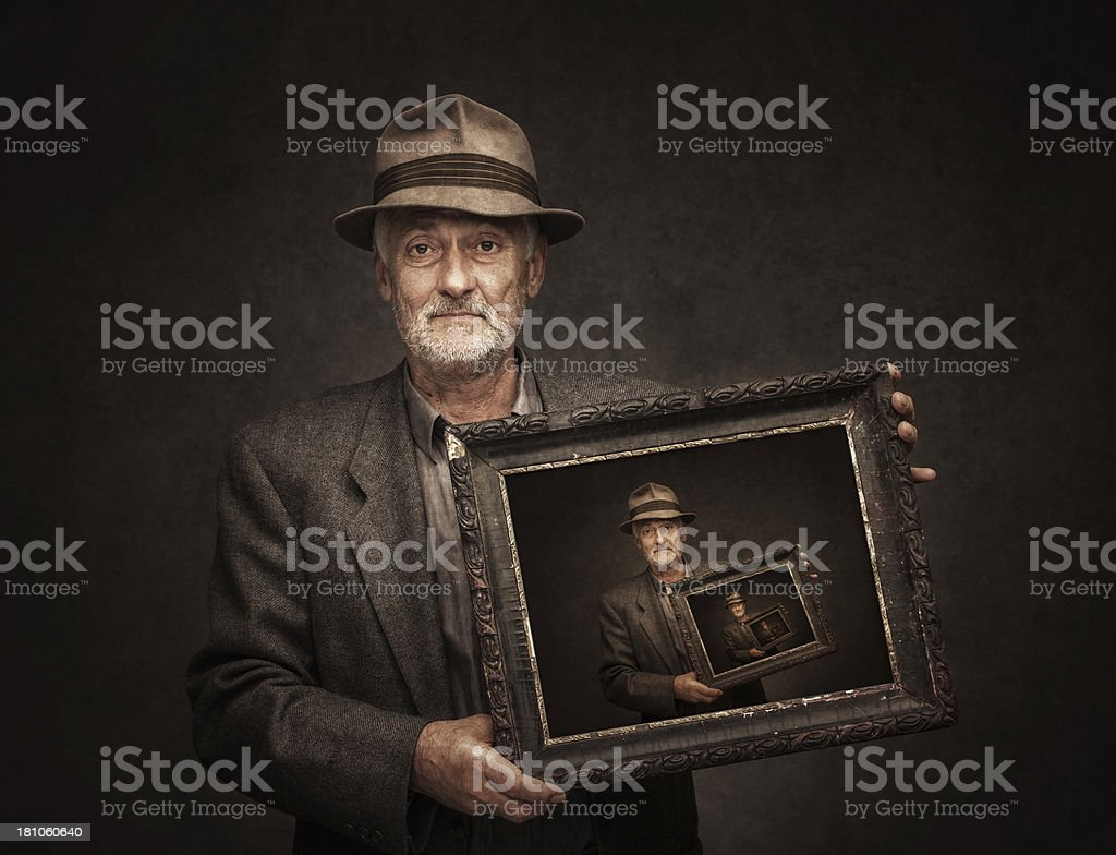 senior man with pictures of himself royalty-free stock photo