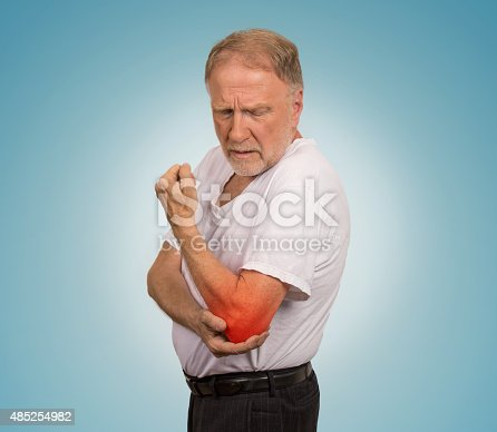 istock senior man with red elbow inflammation suffering from pain 485254982