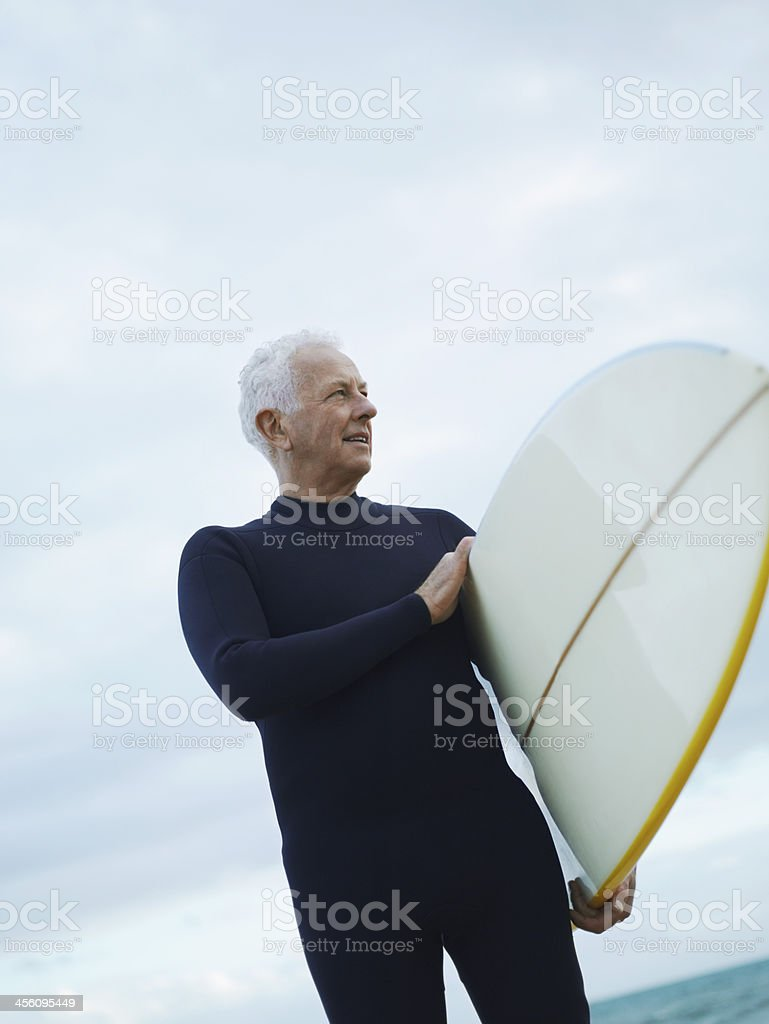Senior Man with Surfboard royalty-free stock photo