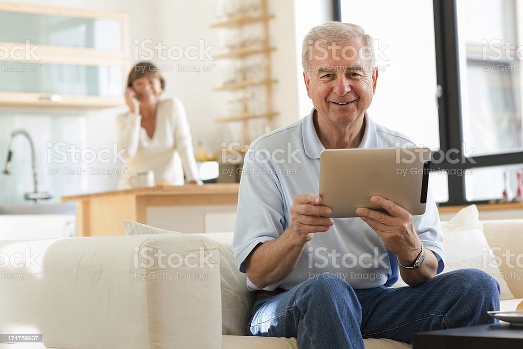 Senior Man with tablet computer stock photo