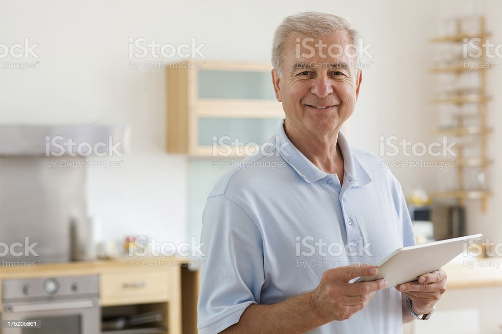 Senior man with tablet computer royalty-free stock photo
