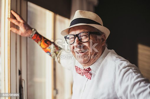 istock Senior man with tattoo smiling and looking at camera 535295995