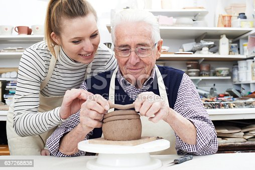 istock Senior Man With Teacher In Pottery Class 637268838