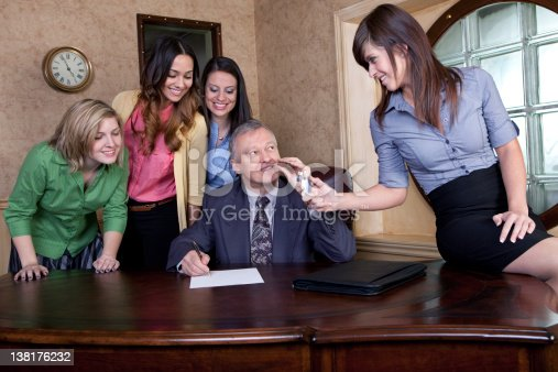 istock Senior man with team of young women 138176232