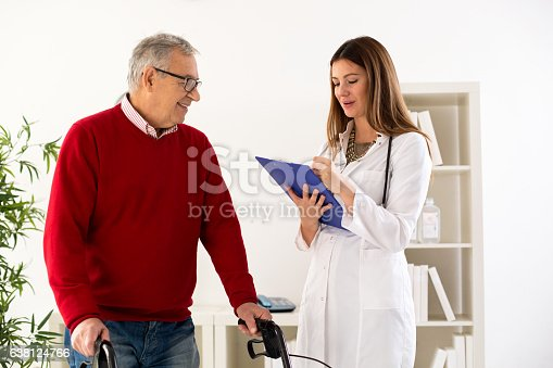 istock Senior man with walker on consultation with doctor 638124766